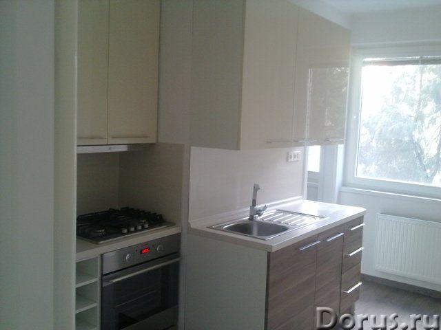 Продается 3-комнатная обновленная квартира с лоджией в центре Комарно, 2-й этаж в 5-этажном кирпично..., фото 2